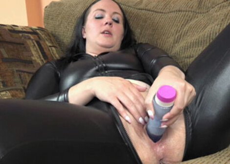 Selena Sky's playing in a vinyl catsuit