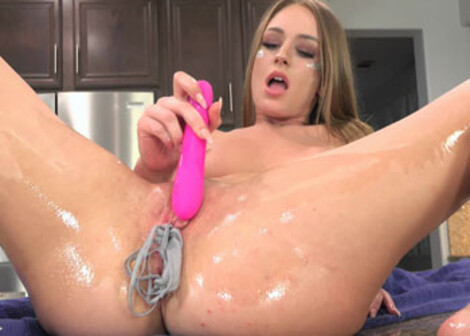 Daisy Stone oils up and stuffs her panties